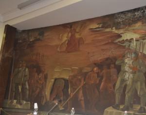 opera del grande artista Santagata dove viene rappresentato l'Isonzo a Gorizia e nello sfondo il ponte ferroviario conquistato da Balelli.